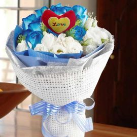 12 Blue Roses with heart shape Tag at centre
