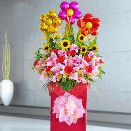 SunFlower, Gerbera & Artificial Lily Arrangement in Box Stand