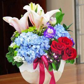 Blue Hydrangeas, Lilies & Red Roses in Vase Arrangement